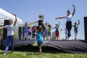 Visitors participate in a Kansas City Ballet workshop on the Community Partner Stage at Future Stages Festival 2017