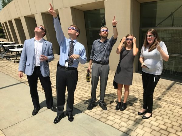 Kauffman Center staff watch the 2017 solar eclipse.